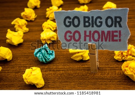 Writing note showing  Go Big Or Go Home Motivational Call. Business photo showcasing Mindset Ambitious Impulse Persistence Cardboard with letters wooden floor fuzzy yellow lumps green hunch. #1185418981