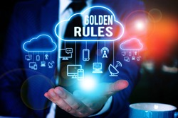 Writing note showing Golden Rules. Business photo showcasing Basic principle that should be followed Important Principle Male wear formal work suit presenting presentation smart device.