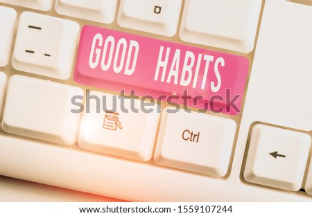 Writing note showing Good Habits. Business photo showcasing behaviour that is beneficial to one s is physical or mental health White pc keyboard with note paper above the white background.
