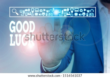 Writing note showing Good Luck. Business photo showcasing A positive fortune or a happy outcome that a demonstrating can have Male wear formal work suit presenting presentation smart device.