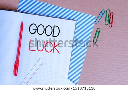 Writing note showing Good Luck. Business photo showcasing A positive fortune or a happy outcome that a demonstrating can have Striped paperboard notebook cardboard office study supplies chart paper.