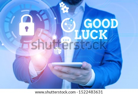 Writing note showing Good Luck. Business photo showcasing A positive fortune or a happy outcome that a demonstrating can have Male human wear formal suit presenting using smart device.