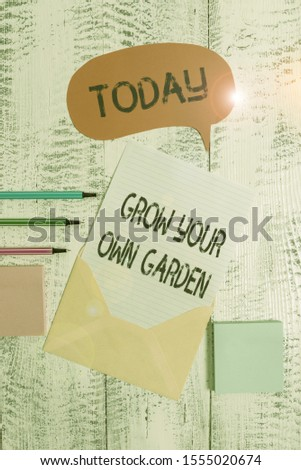 Writing note showing Grow Your Own Garden. Business photo showcasing Organic Gardening collect demonstratingal vegetables fruits Envelop speech bubble paper sheet ballpoints notepads wooden background