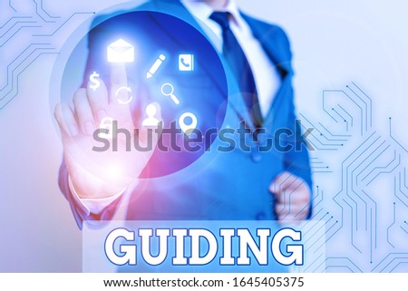 Writing note showing Guiding. Business photo showcasing to show someone how to do something difficult Indicate the way.