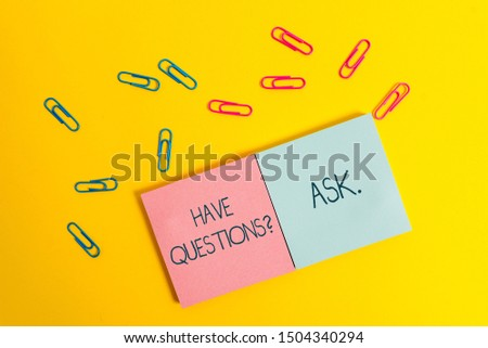Writing note showing Have Questionsquestion Ask. Business photo showcasing something that you say or write to ask a demonstrating Colored square blank sticky notepads sheets clips color background.