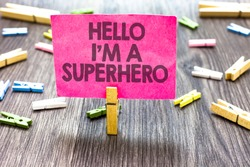 Writing note showing Hello I am A Superhero. Business photo showcasing Believing in yourself Self-confidence Introduction Multiple clips woody table small card clipped notice announcement.