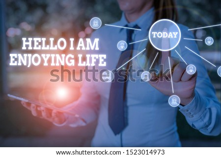 Writing note showing Hello I Am Enjoying Life. Business photo showcasing Happy relaxed lifestyle Enjoy simple things Woman wear formal work suit presenting presentation using smart device. #1523014973