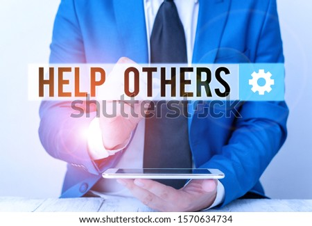 Writing note showing Help Others. Business photo showcasing the action of helping someone to do something or assistance Businessman pointing with pen in empty copy space.