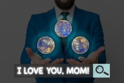Writing note showing I Love You, Mom. Business photo showcasing Loving message emotional feelings affection warm declaration Elements of this image furnished by NASA.