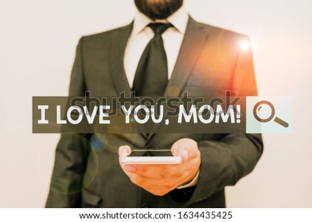 Writing note showing I Love You, Mom. Business photo showcasing Loving message emotional feelings affection warm declaration Male human wear formal work suit hold smartphone using hand.