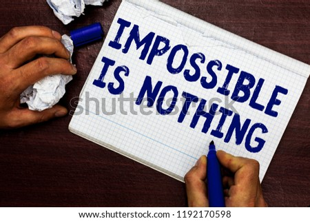 Writing note showing Impossible Is Nothing. Business photo showcasing Anything is Possible Believe the Realm of Possibility Man holding marker notebook page crumpled paper several tries mistakes. #1192170598