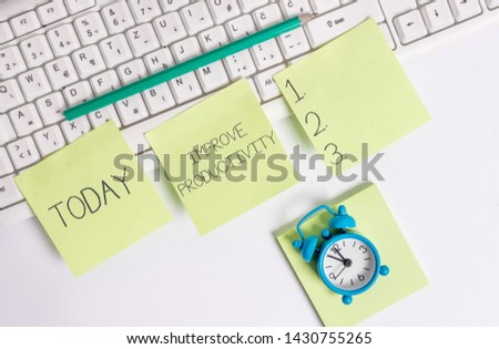 Writing note showing Improve Productivity