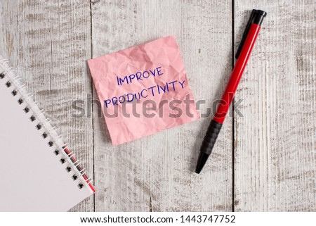 Writing note showing Improve Productivity. Business photo showcasing to increase the machine and process efficiency Wrinkle paper notebook and stationary placed on wooden background.