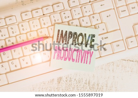 Writing note showing Improve Productivity. Business photo showcasing to increase the machine and process efficiency Keyboard office supplies rectangle shape paper reminder wood.