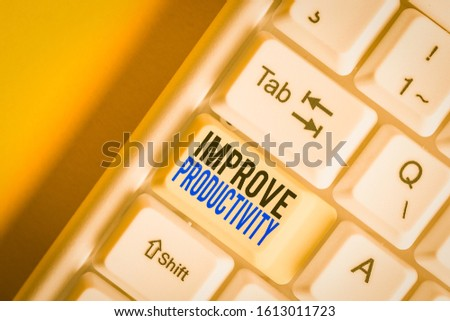 Writing note showing Improve Productivity. Business photo showcasing to increase the machine and process efficiency White pc keyboard with note paper above the white background.