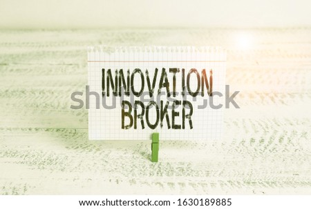 Writing note showing Innovation Broker. Business photo showcasing help to mobilise innovations and identify opportunities Green clothespin white wood background reminder office supply.