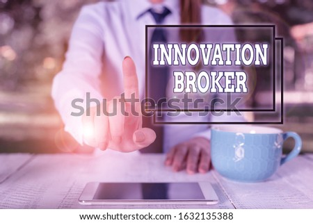 Writing note showing Innovation Broker. Business photo showcasing help to mobilise innovations and identify opportunities Business woman sitting by the table with cup of coffee and mobile phone.