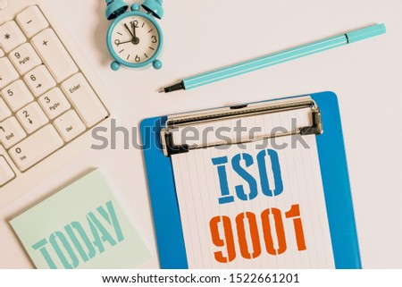 Writing note showing Iso 9001. Business photo showcasing designed help organizations to ensure meet the needs of customers Flat lay above table with clock pc keyboard and copy space note paper. #1522661201