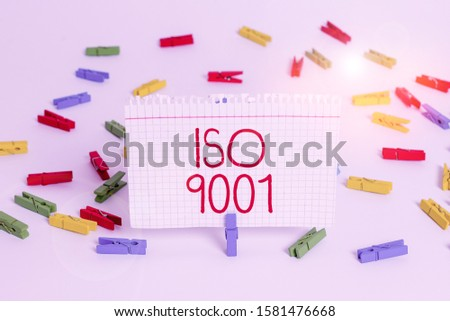 Writing note showing Iso 9001. Business photo showcasing designed help organizations to ensure meet the needs of customers Colored clothespin papers empty reminder white floor background office.