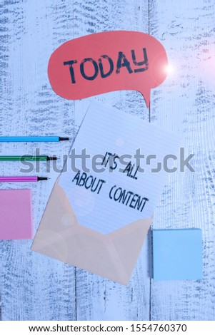 Writing note showing It S All About Content. Business photo showcasing Express thru Writing Information and Experience Envelop speech bubble paper sheet ballpoints notepads wooden background.