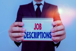 Writing note showing Job Descriptions. Business photo showcasing a formal account of an employee s is responsibilities Male human wear formal work suit with office look hold book.