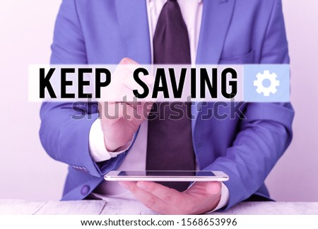 Writing note showing Keep Saving. Business photo showcasing keeping money in an account in a bank or financial organization Businessman pointing with pen in empty copy space.