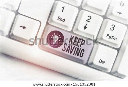 Writing note showing Keep Saving. Business photo showcasing keeping money in an account in a bank or financial organization White pc keyboard with note paper above the white background.