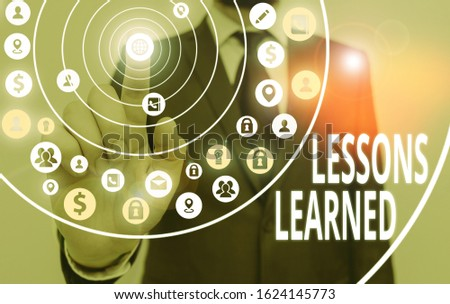 Writing note showing Lessons Learned. Business photo showcasing the knowledge or understanding gained by experience.