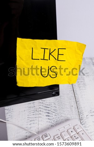 Writing note showing Like Us. Business photo showcasing Asking to follow on social media Feel attraction or pleasure Notation paper computer monitor screen near white keyboard. #1573609891