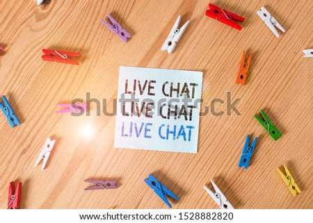 Writing note showing Live Chat Live Chat Live Chat. Business photo showcasing talking with showing friends relatives online Colored clothespin papers empty reminder wooden floor background office.