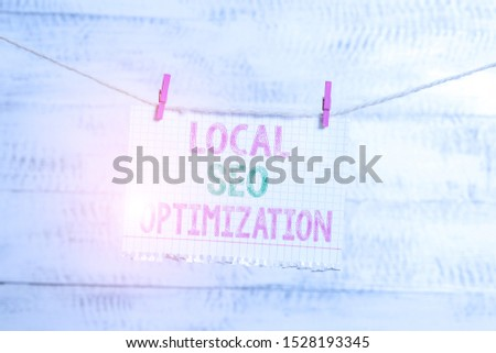 Writing note showing Local Seo Optimization. Business photo showcasing increase Search Visibility to Rank on Top list Clothesline clothespin rectangle shaped paper reminder white wood desk.