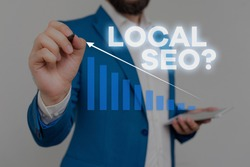 Writing note showing Local Seo question. Business photo showcasing incredibly effective way to market your local business online Male wear formal work suit presenting presentation smart device.