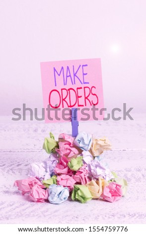 Writing note showing Make Orders. Business photo showcasing A confirmed request by one party to another to buy or sell Reminder pile colored crumpled paper clothespin wooden space.