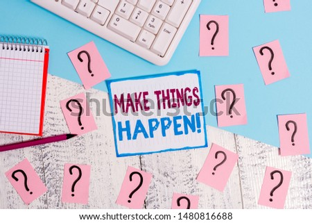 Writing note showing Make Things Happen. Business photo showcasing you will have to make hard efforts in order to achieve it Writing tools and scribbled paper on top of the wooden table.