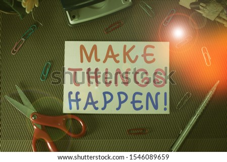 Writing note showing Make Things Happen. Business photo showcasing you will have to make hard efforts in order to achieve it Scissor and writing equipments sheet above textured backdrop.