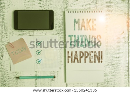 Writing note showing Make Things Happen. Business photo showcasing you will have to make hard efforts in order to achieve it Square spiral notebook marker smartphone sticky note on wood background.