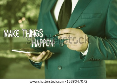 Writing note showing Make Things Happen. Business photo showcasing you will have to make hard efforts in order to achieve it Businessman holds laptop and pen pointing into the copy space.
