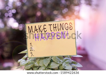 Writing note showing Make Things Happen. Business photo showcasing you will have to make hard efforts in order to achieve it Plain paper attached to stick and placed in the grassy land.
