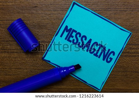 Writing note showing Messaging. Business photo showcasing Communication with others through messages Texting Chatting Blue Paper Important reminder Communicate ideas Wooden background. #1216223614