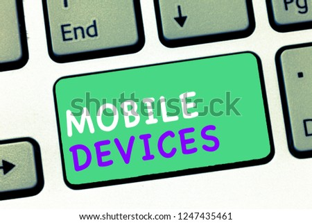 Writing note showing Mobile Devices. Business photo showcasing A portable computing device like smartphone tablet computer #1247435461