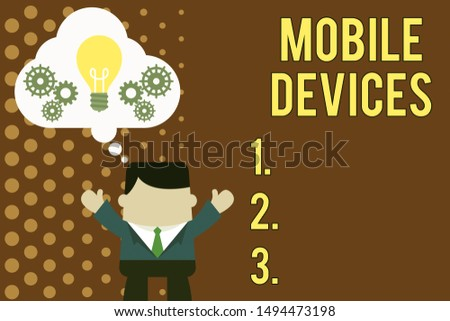 Writing note showing Mobile Devices. Business photo showcasing A portable computing device like smartphone tablet computer Man hands up imaginary bubble light bulb working together.