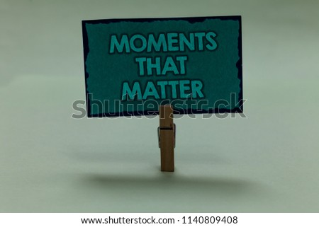 Writing note showing Moments That Matter. Business photo showcasing Meaningful positive happy memorable important times paperclip grip black lined green page with outlines grey background. #1140809408
