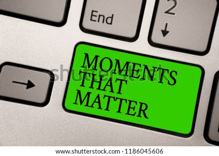 Writing note showing Moments That Matter. Business photo showcasing Meaningful positive happy memorable important times Silver grey computer keyboard green button with black letters. #1186045606