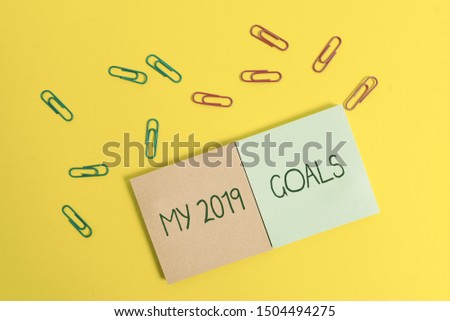 Writing note showing My 2019 Goals. Business photo showcasing setting up demonstratingal goals or plans for the current year Colored square blank sticky notepads sheets clips color background.