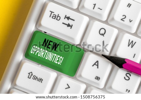Writing note showing New Opportunities. Business photo showcasing exchange views condition favorable for attainment goal White pc keyboard with note paper above the white background.