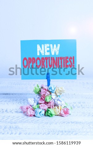 Writing note showing New Opportunities. Business photo showcasing exchange views condition favorable for attainment goal Reminder pile colored crumpled paper clothespin wooden space.