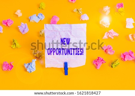 Writing note showing New Opportunities. Business photo showcasing exchange views condition favorable for attainment goal Colored crumpled paper empty reminder white floor clothespin.