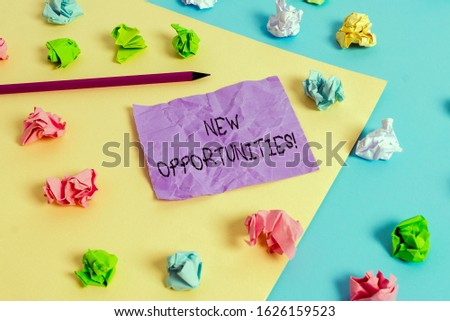 Writing note showing New Opportunities. Business photo showcasing exchange views condition favorable for attainment goal Colored crumpled papers empty reminder blue yellow clothespin.