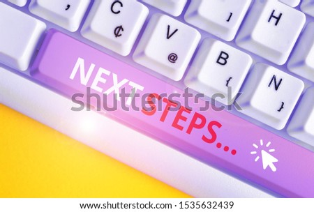 Writing note showing Next Steps. Business photo showcasing something you do after you have finished doing first one White pc keyboard with note paper above the white background. #1535632439