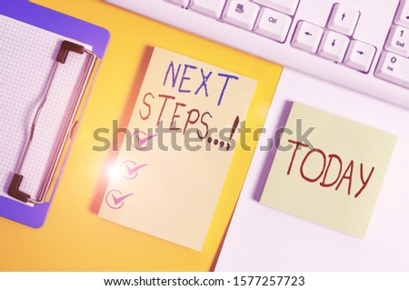 Writing note showing Next Steps. Business photo showcasing something you do after you have finished doing first one Paper with copy space and keyboard above orange background table. #1577257723